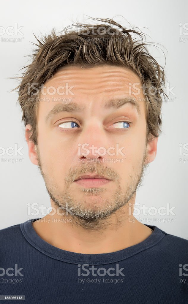 Close-up portrait of a young man, looking sideways. stock photo