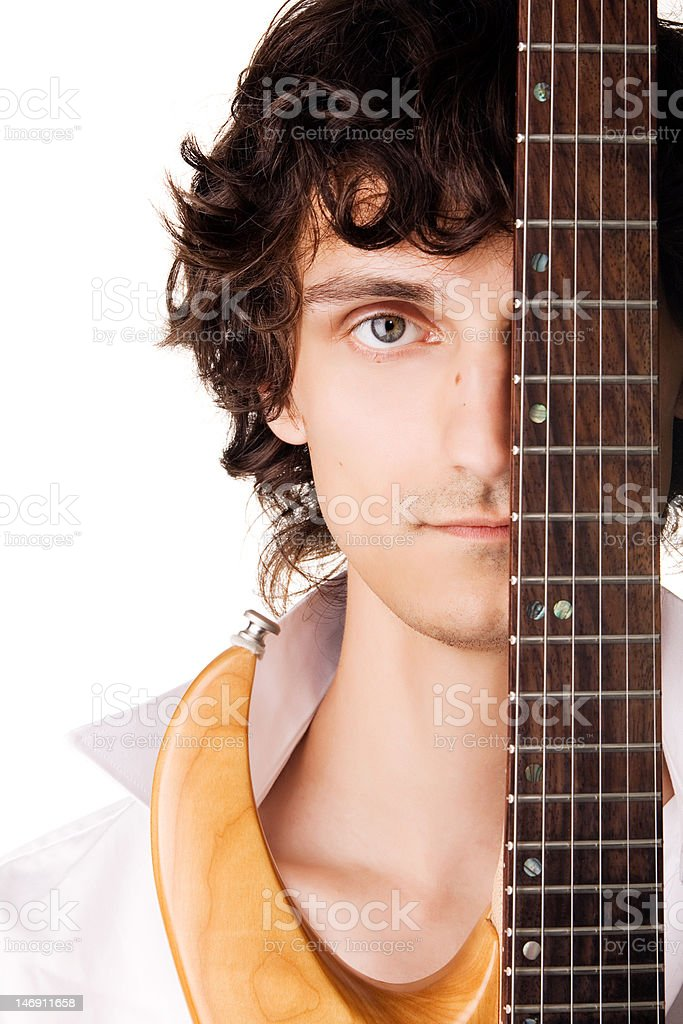 Close-up portrait of a young man with electric guitar royalty-free stock photo
