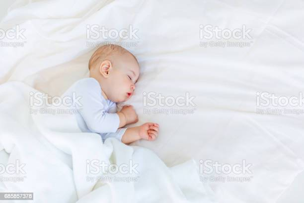 Closeup portrait of adorable baby boy sleeping in bed 1 year old baby picture id685857378?b=1&k=6&m=685857378&s=612x612&h=ooxjzfxtqlqurjqyazir9c0k9w9jpxxaii73aqyg5d0=