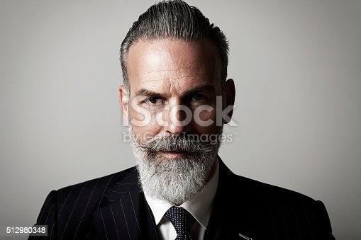istock Closeup portrait of adult businessman wearing trendy suit  against the 512980348