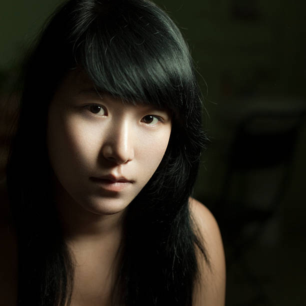 Close-up portrait of an Asian teenage girl looking at camera. stock photo