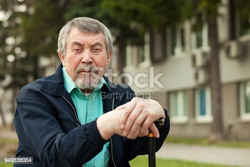 close-up portrait of an old man on a walk in the park