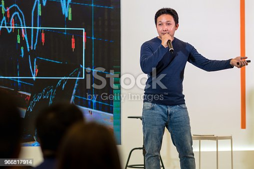 1158085965 istock photo Closeup portrait of asian Speaker with casual suit on the stage over the presentation screen in the business or education seminar 966817914