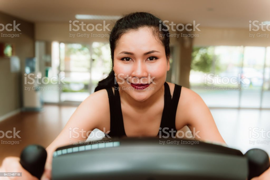 e11e82db8f5 Closeup Portrait Of Asian Woman Workout On Cycling In Fitness Gym ...