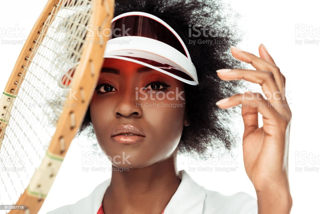 close-up portrait of attractive female tennis player isolated on white stock photo