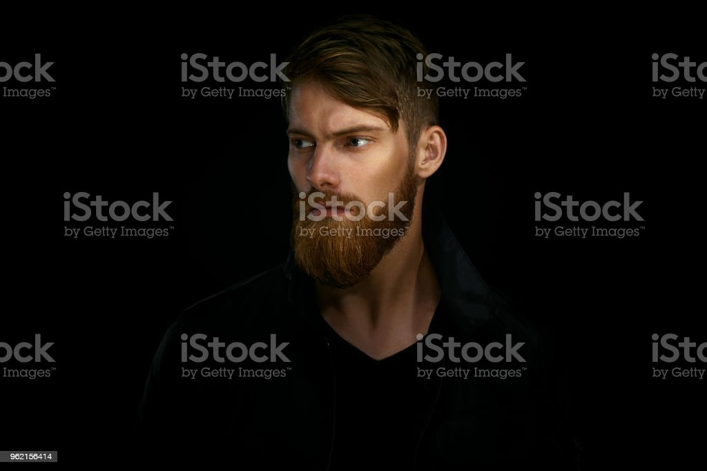 Closeup portrait of bearded handsome man in a pensive mood looki stock photo