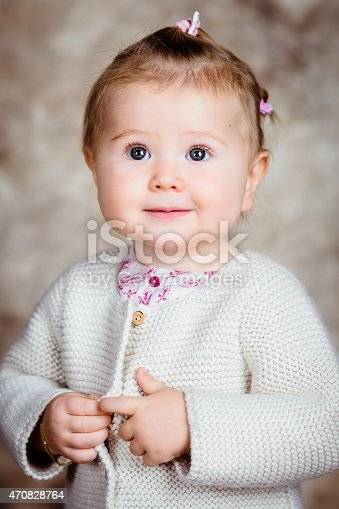 istock Close-up portrait of beautiful blond little girl with big grey 470828764