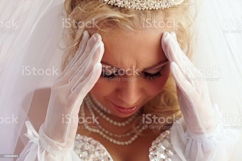 close-up portrait of beautiful bride frowned on troubles. white background royalty-free stock photo