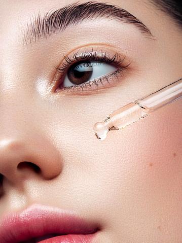 Close-up portrait of beautiful girl getting skin anti aging treatment