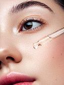 istock Close-up portrait of beautiful girl getting skin anti aging treatment 1272479964
