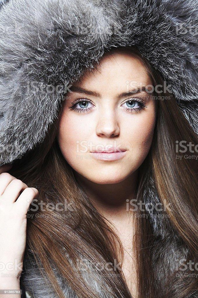 Close-up portrait of beautiful girl wearing furs royalty-free stock photo