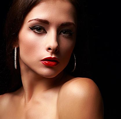 closeup portrait of beautiful makeup woman on black