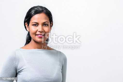Close-up of beautiful mid adult manager. Portrait of female professional is smiling. She is against white background.