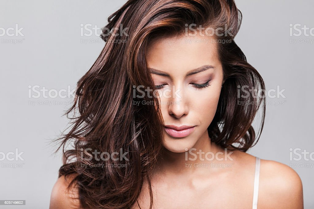 Close-up portrait of beautiful woman looking down stock photo