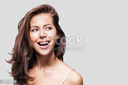 istock Close-up portrait of beautiful woman 625749570