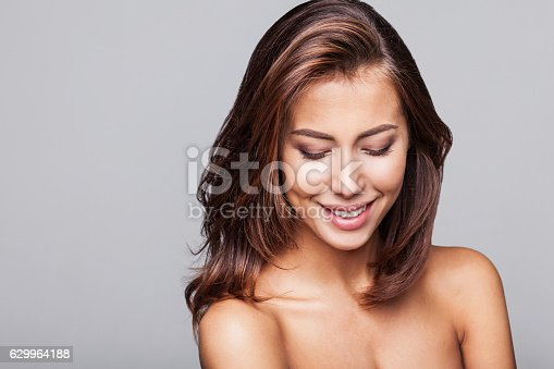 istock Close-up portrait of beautiful woman 629964188