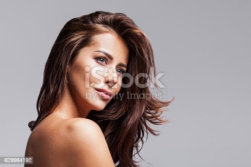 istock Close-up portrait of beautiful woman 629964192