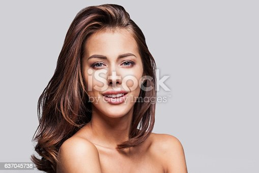 istock Close-up portrait of beautiful woman 637045738
