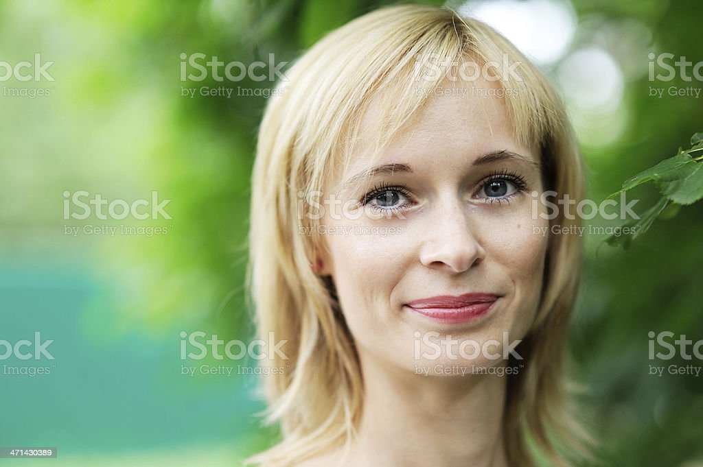 Close-up portrait of beautiful young blond woman stock photo