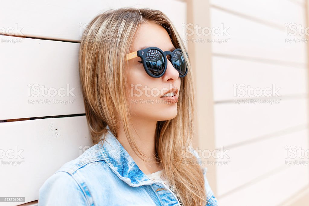 Close-up portrait of beautiful young girl in sunglasses and jacket stock photo