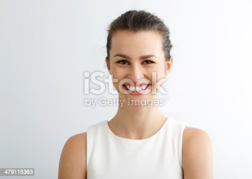 istock Close-up portrait of beautiful young woman looking at camera 479115363