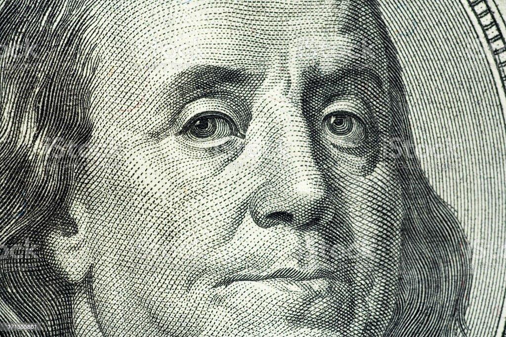 Closeup portrait of Benjamin Franklin on hundred dollar bill stock photo