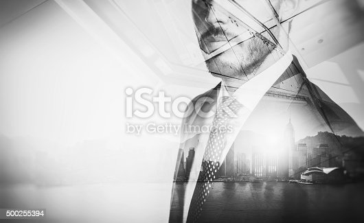 istock Close-up portrait of businessman. Double exposure city at sunrise 500255394