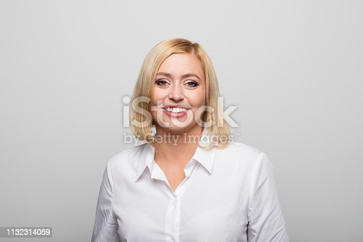 1132314350 istock photo Close-up portrait of businesswoman smiling 1132314059