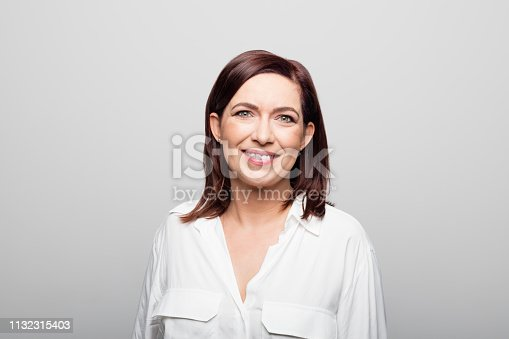 1132314350 istock photo Close-up portrait of businesswoman smiling 1132315403