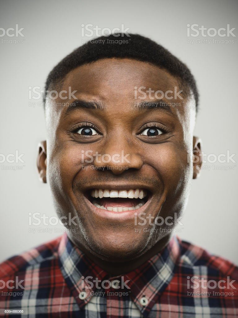 Close-up portrait of cheerful surprised man stock photo
