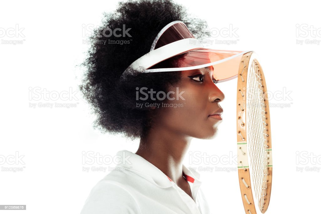 close-up portrait of concentrated young female tennis player with racket isolated on white stock photo