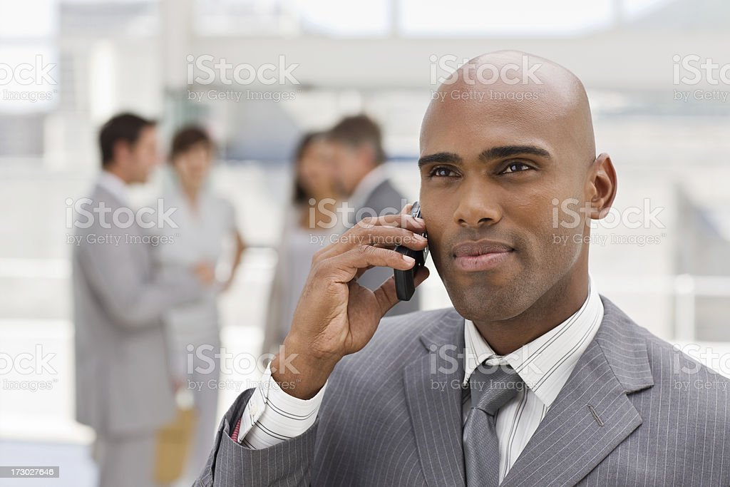 Closeup portrait of confident businessman talking on phone royalty-free stock photo