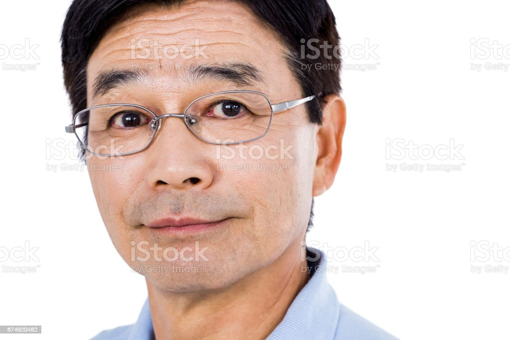 Close-up portrait of confident man wearing eyeglasses royalty-free stock photo