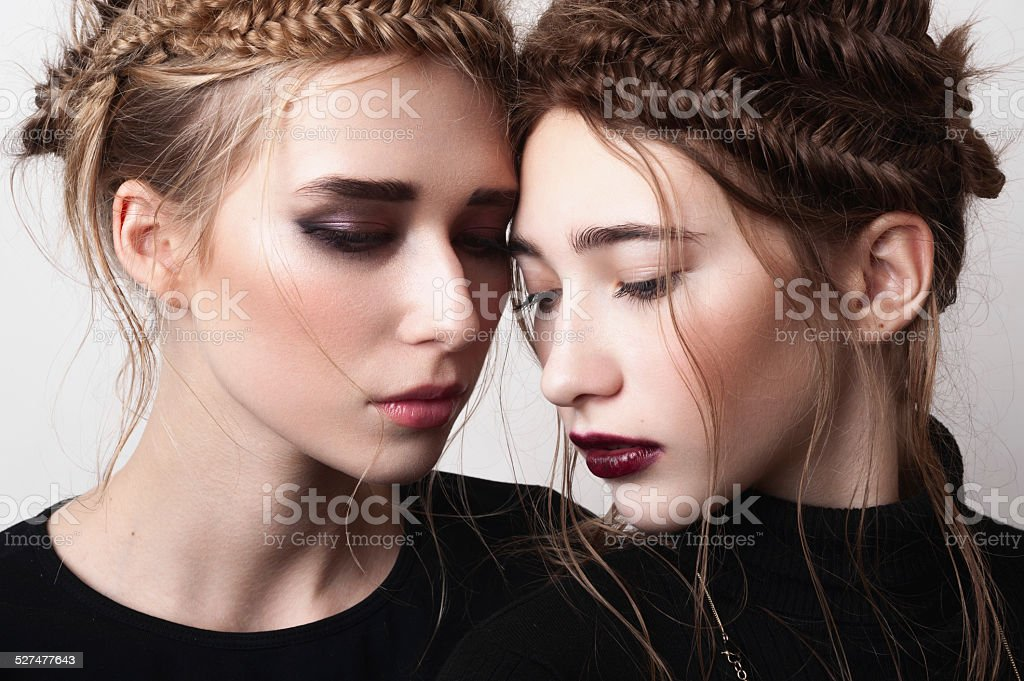 Close-up portrait of couple beauty girls with pigtails stock photo