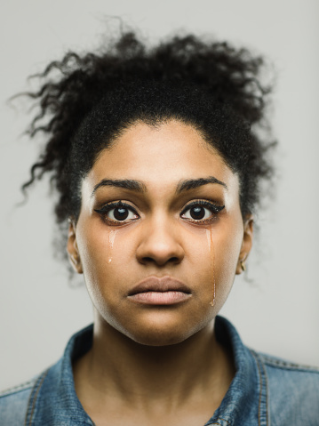 istock Close-up portrait of crying young afro american woman 666991546