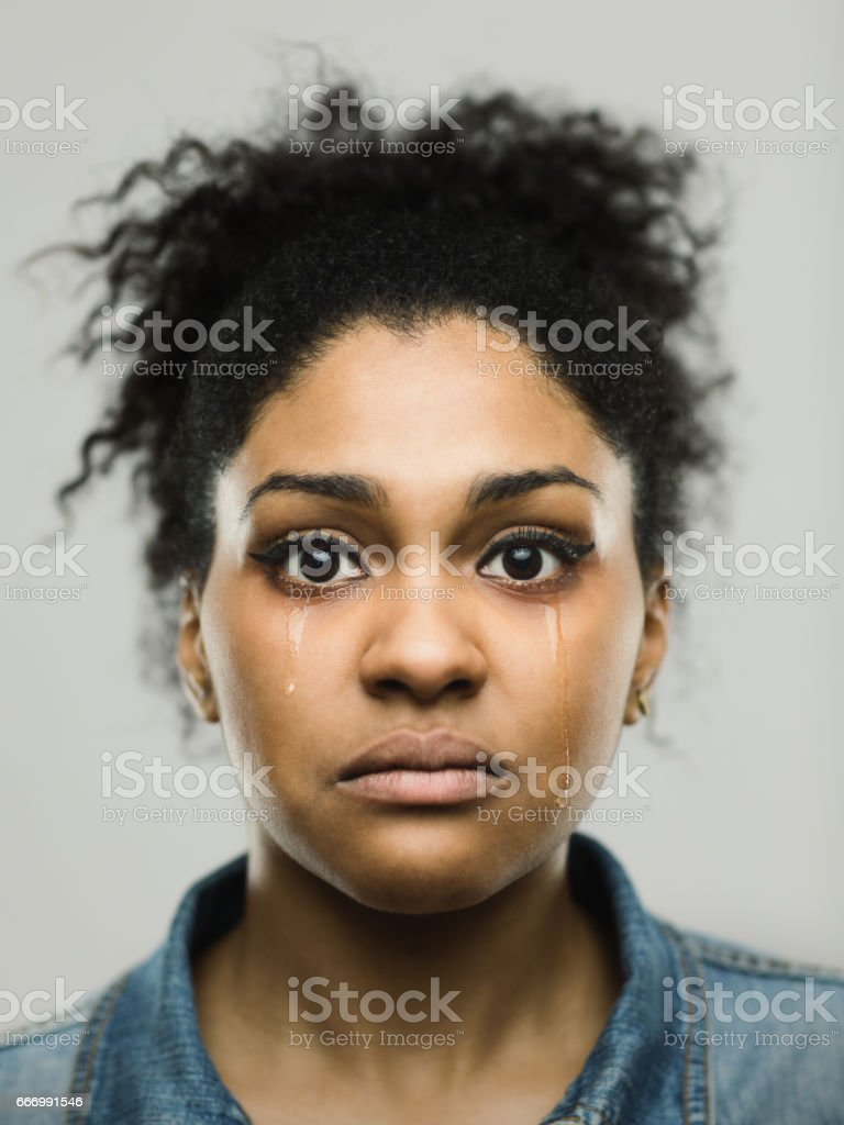 Close-up portrait of crying young afro american woman stock photo