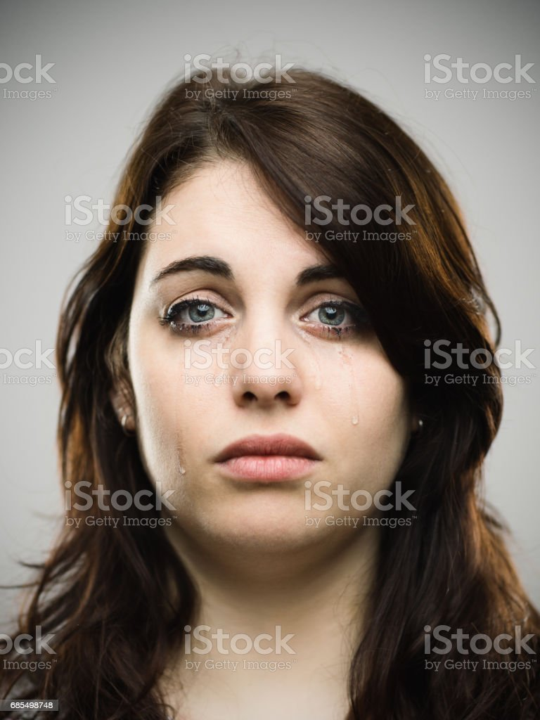 Close-up portrait of crying young woman stock photo