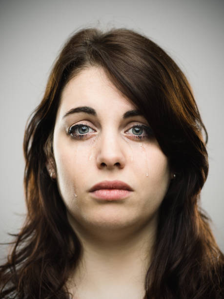 close-up portrait of crying young woman - frowning stock photos and pictures