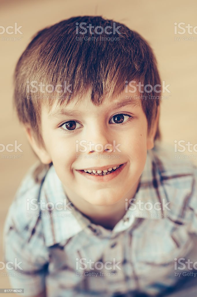 Closeup Portrait Of Cute Smiling Little Boy With Brown Eyes Stock