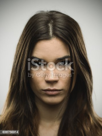 istock Close-up portrait of depressed young woman 638756914