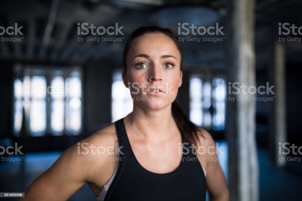 Close-up portrait of determined athlete in gym stock photo