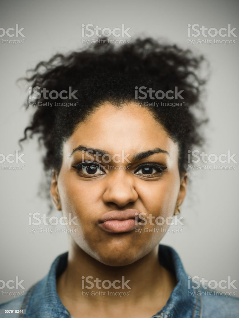 Close-up portrait of displeased young afro american woman stock photo