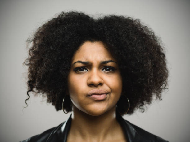 close-up portrait of displeased young afro american woman - frowning stock photos and pictures