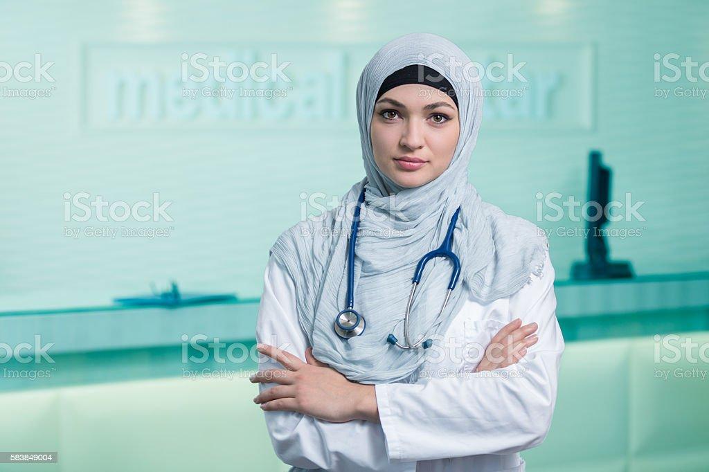 Closeup portrait of friendly, smiling confident muslim female doctor. stock photo