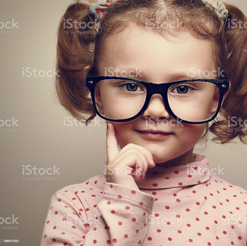Closeup portrait of fun happy  kid girl in glasses. Vintage stock photo