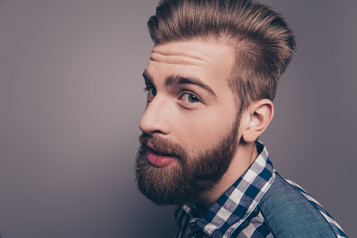 636829368 istock photo Closeup portrait of funny glad hipster bearded man looking at camera, side-view photo 948761646