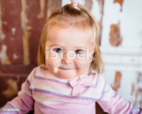 istock Close-up portrait of funny little girl with big grey eyes 470836564