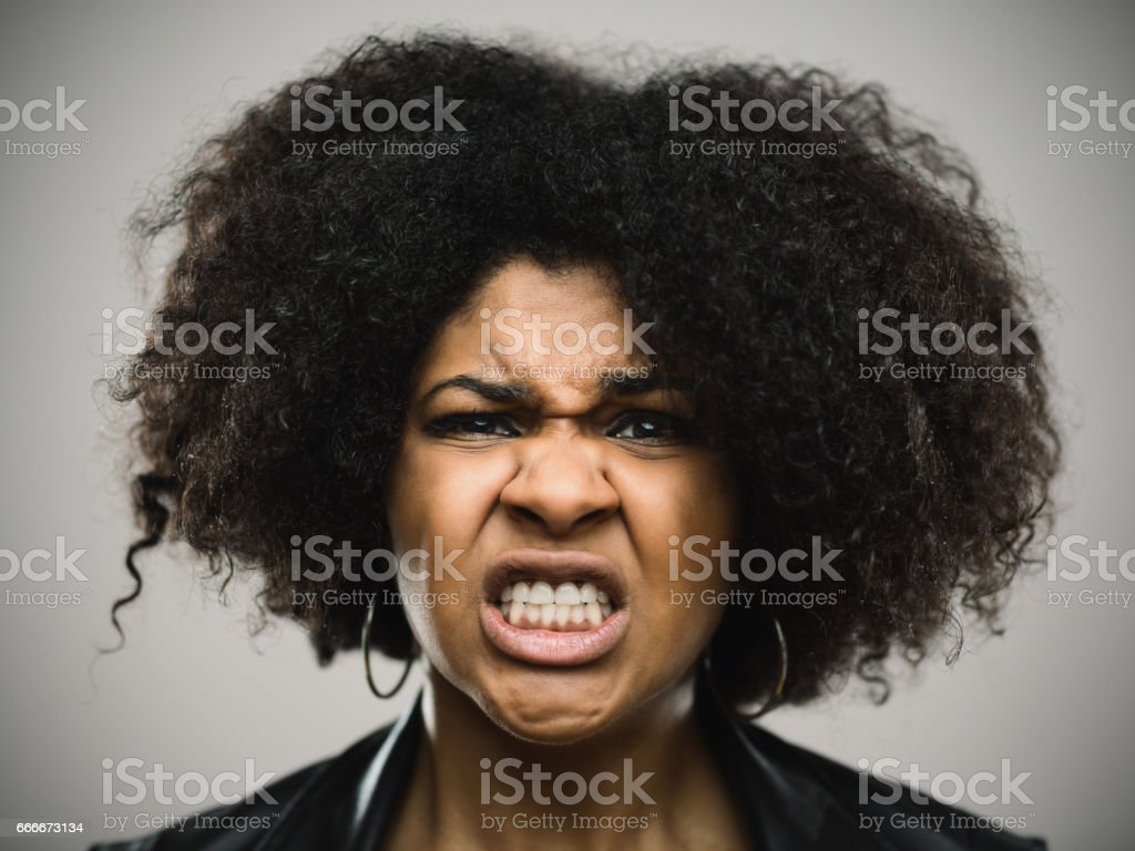 Close-up portrait of furious young afro american woman stock photo