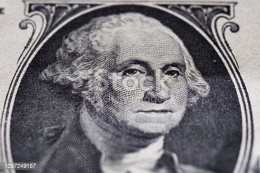 Portrait of George Washington on 1 dollar bill extreme close-up
