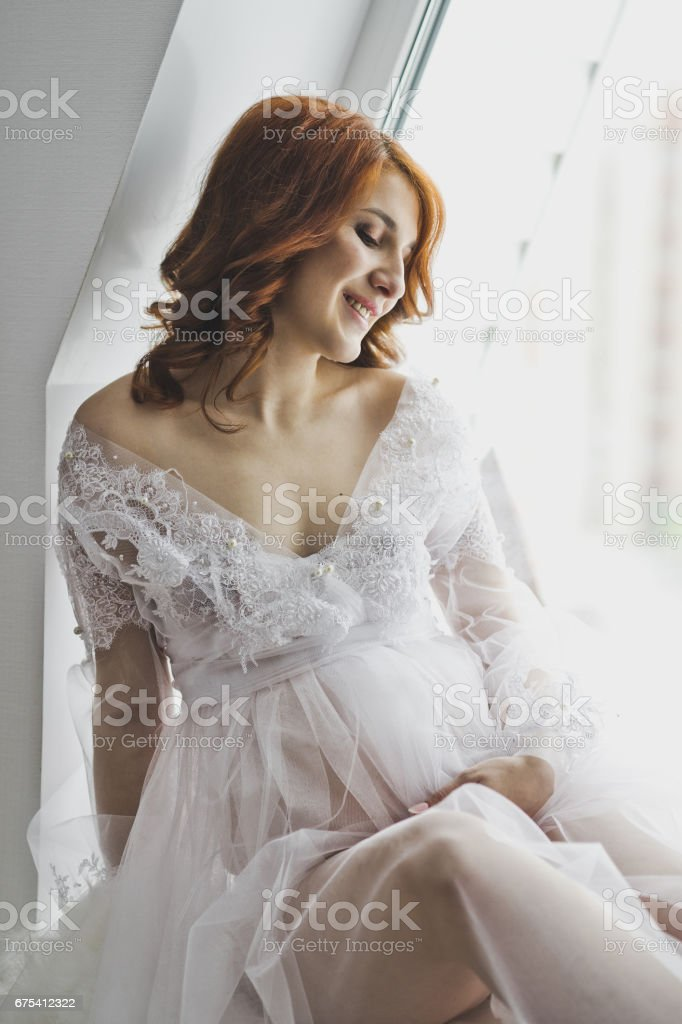 Close-up portrait of girl in a negligee on background of the window 6873. royalty-free stock photo
